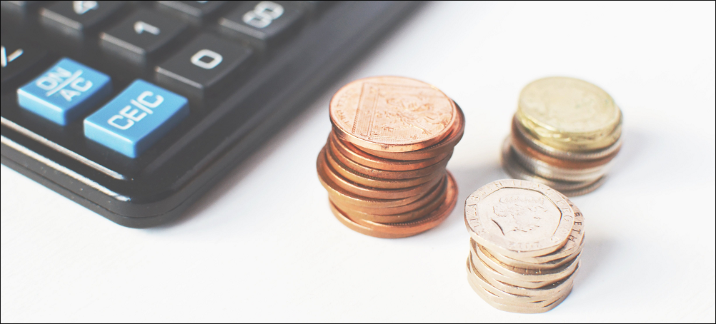 piles-of-coins-and-calculator_copertina_border.png
